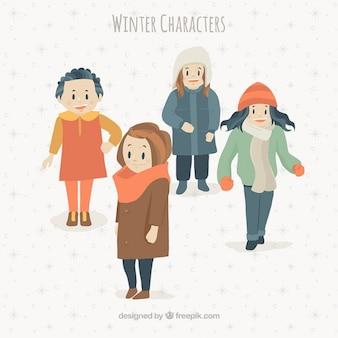 Les jeunes avec des vêtements d'hiver