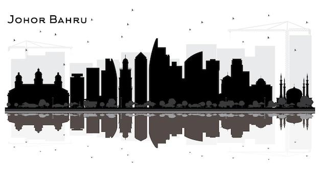 Johor bahru malaisie ville silhouette avec bâtiments noirs et reflets