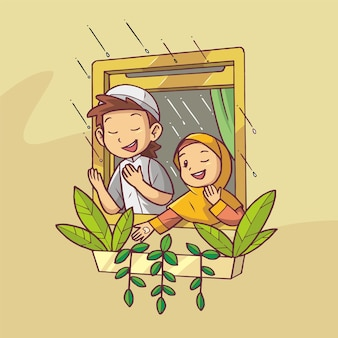 La joie du frère et de la soeur priant avec la pluie sur la fenêtre