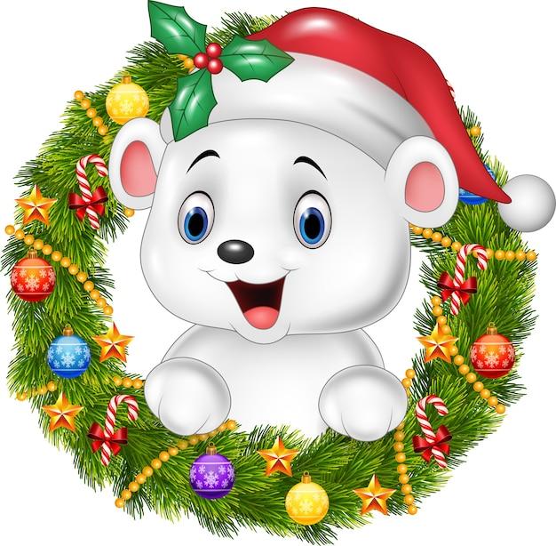 Joli bébé ours polaire tenant une couronne de noël