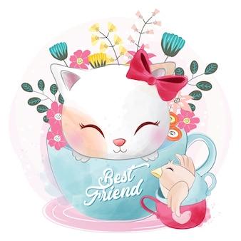 Joli chat assis dans la tasse à thé