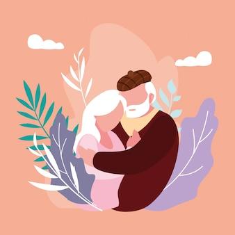 Joli couple âgé embrassé avec décoration de feuilles