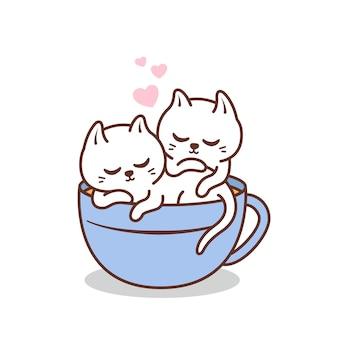 Joli couple chat blanc à l'intérieur de la tasse de café