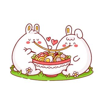 Joli couple de lapins drôles heureux mange des ramen dans un bol