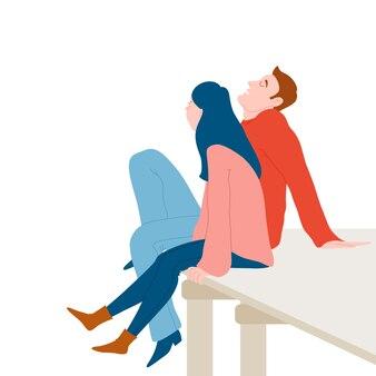 Joli couple romantique assis sur un quai en bois, se détendre ensemble
