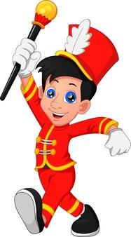 Joli garçon vêtu d'un costume de chef de fanfare