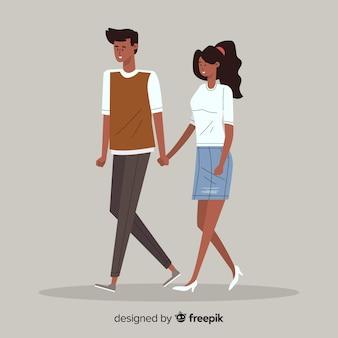 Joli jeune couple marchant ensemble