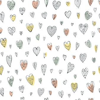 Joli motif de doodle sans couture avec différents coeurs.
