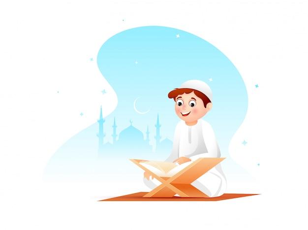 Joli petit garçon lisant un livre sacré