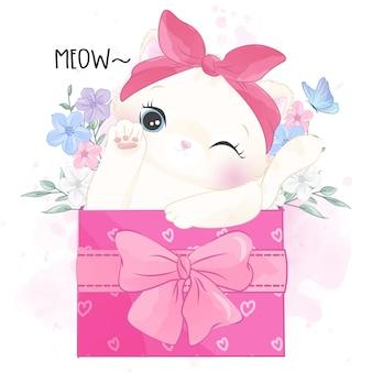 Joli petit minou assis à l'intérieur du coffret cadeau