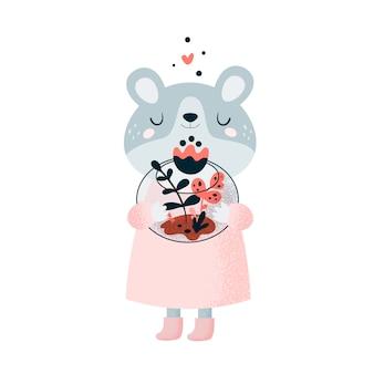 Joli petit ours en peluche avec des fleurs