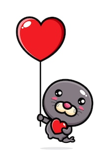 Joli phoque volant avec un ballon d'amour