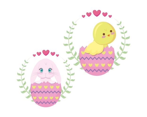 Joli poulet et lapin de pâques dans les œufs