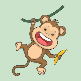 Joli singe suspendu tenant une banane