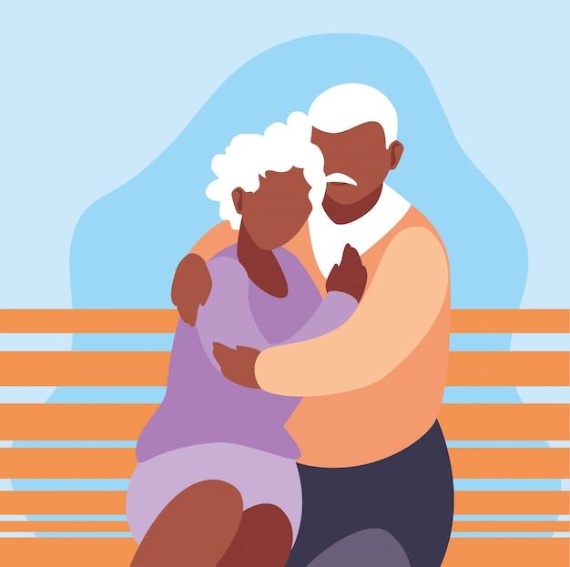 Joli vieux couple assis sur une chaise de parc