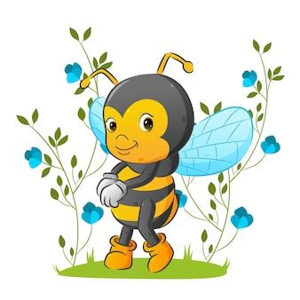 La jolie abeille est debout dans le beau jardin avec l'ornement de fleurs d'illustration