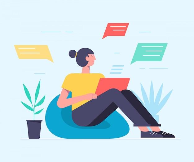 Jolie femme est assise devant son ordinateur portable et discute. illustration, style plat, les hommes d'affaires discutent des réseaux sociaux, des nouvelles, des réseaux sociaux, du chat.