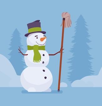 Jolie figurine de bonhomme de neige avec une vadrouille