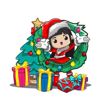 Jolie fille avec arbre de noël et cadeaux