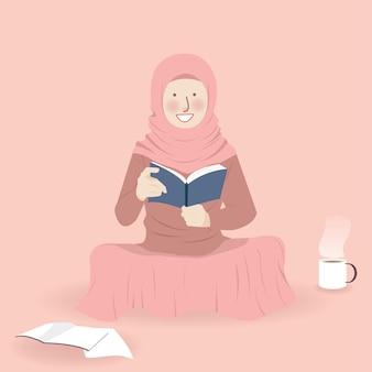 Jolie fille musulmane lisant joyeusement un livre dans une pièce avec des boissons