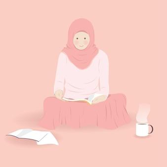 Jolie fille musulmane lisant un livre dans une chambre avec boisson