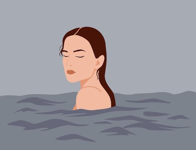 Jolie fille nage dans la mer