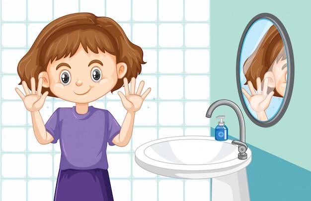 Jolie fille, nettoyage des mains dans les toilettes