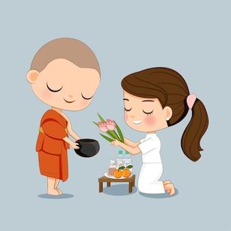 Jolie fille en robe blanche offrant la nourriture à un dessin animé de moine