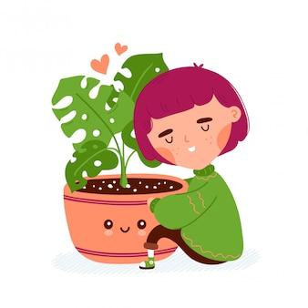 Jolie fille souriante heureuse câlin pot avec plante.
