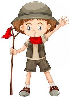 Jolie fille en tenue de safari tenant le bâton sur blanc