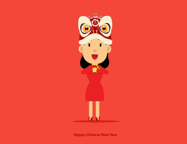 Jolie fille avec tête de danse lion nouvel an chinois