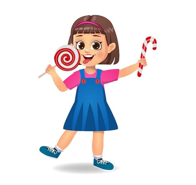 Jolie petite fille mange des bonbons. isolé
