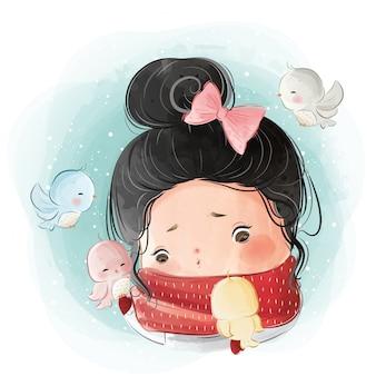 Jolie petite fille avec des oiseaux