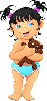 Jolie petite fille tenant une poupée