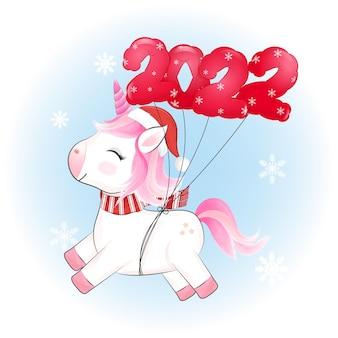 Jolie petite licorne et ballon rouge illustration de noël 2022
