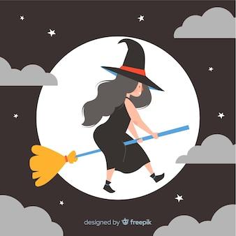 Jolie sorcière d'halloween sur balai