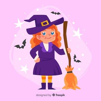 Jolie sorcière d'halloween avec un balai