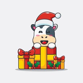 Jolie vache avec un cadeau de noël illustration de dessin animé mignon de noël
