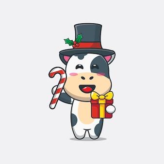 Jolie vache tenant des bonbons de noël et un cadeau illustration de dessin animé de noël mignon