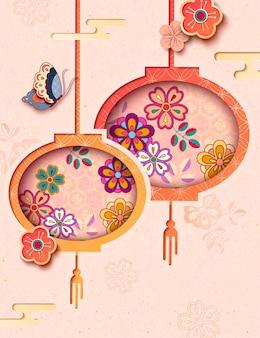 Jolies lanternes florales suspendues avec des papillons sur fond rose clair