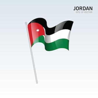 Jordanie, agitant le drapeau isolé sur gris
