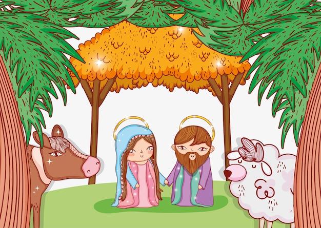Joseph et mary dans la crèche avec vache et mouton