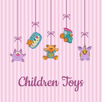 Jouets pour enfants esquissés et colorés suspendus du haut sur une carte rayée rose