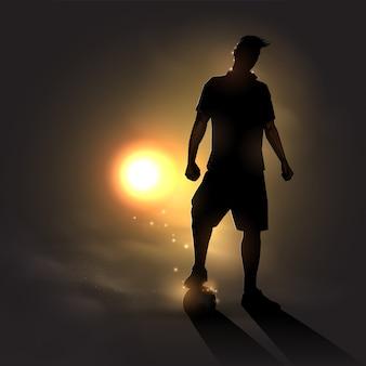 Joueur de football au coucher du soleil