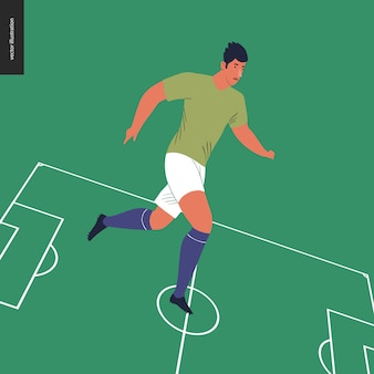 Joueur de football européen sur le terrain de football vert