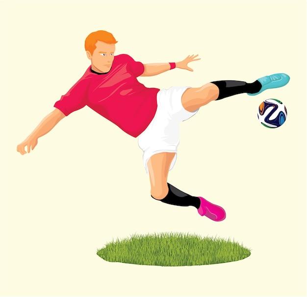 Un joueur de football saute et frappe le ballon