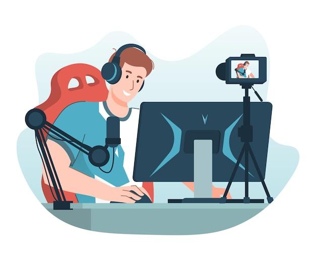 Joueur professionnel jouant à un jeu vidéo en ligne sur un ordinateur personnel tout en enregistrant une vidéo à l'aide d'une caméra et d'un microphone