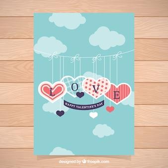 Jour de la carte de la saint-valentin avec des coeurs suspendus