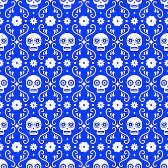Jour du modèle sans couture mort avec des crânes et des fleurs sur fond bleu. conception mexicaine traditionnelle de halloween pour la fête de vacances de dia de los muertos. ornement du mexique.