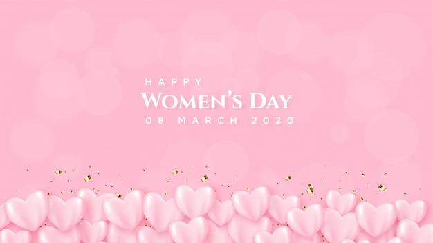 Le jour d'une femme avec un ballon rose avec une écriture blanche.